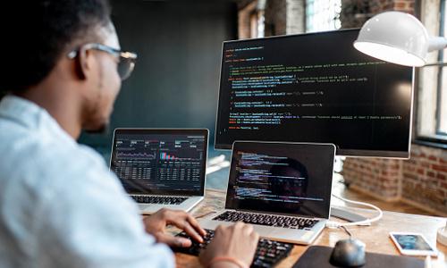 programmer at computer screen